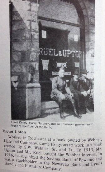 (Tot) Kelley, Harry Gardner, and an unknown gentleman in front of the Ruel Upton Bank.